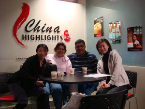 pravin and  prashanta together with karen in the office of China Travel Agency